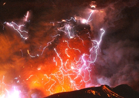Volcanic lightning is seen above Shinmoedake peak, as it erupts, between Miyazaki and Kagoshima prefectures, in this photo taken from Kirishima city